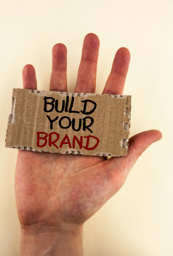 e- Promotions for law firms - a photo of a hand with a sign saying Build your Brand